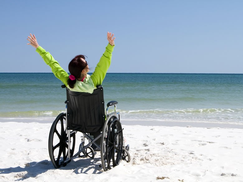 Woman-in-Wheel-Chair-on-Beach